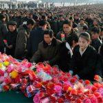 North-Koreans-offer-flower