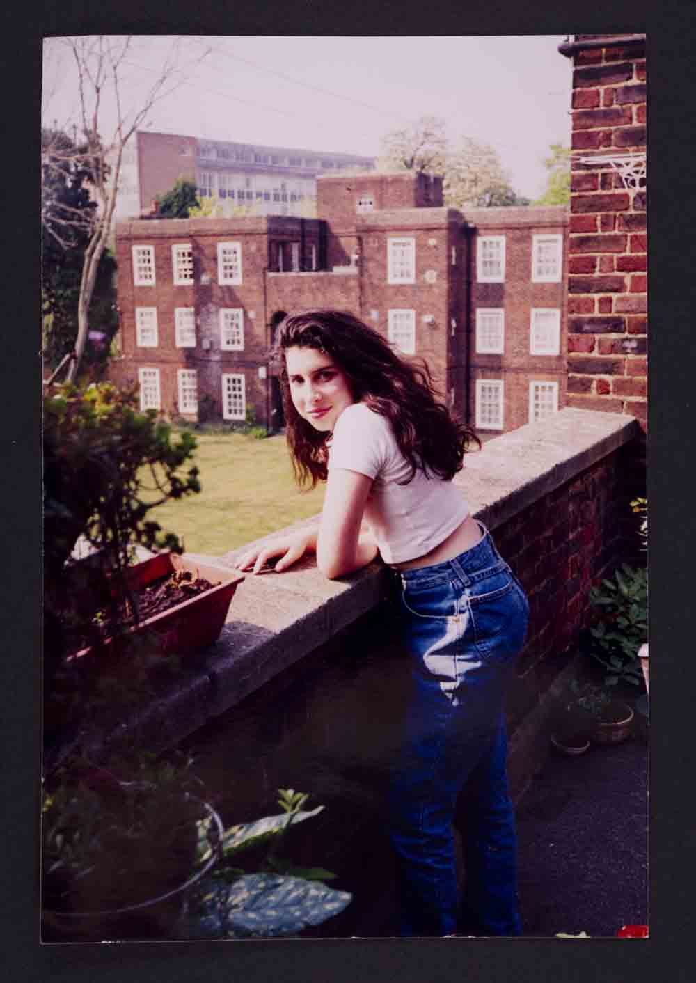 A young Amy outside her Nans flat in Southgate. Photographer unknown The Winehouse family