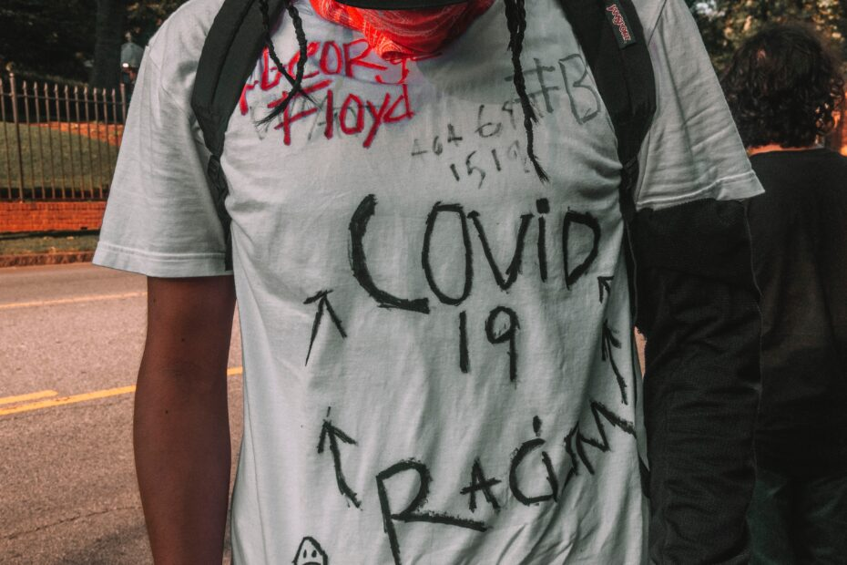 a protestor's shirt with handwritten messages